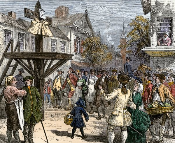 Sons of Liberty penalize a tea looter after Boston Tea Party by nailing his coat to a post, 1773. Hand-colored woodcut of a 19th-century illustration