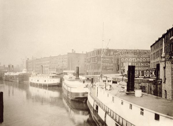 Docks along the Chicago River east of State Street Bridge, 1890s. Albertype reproduction of a photograph