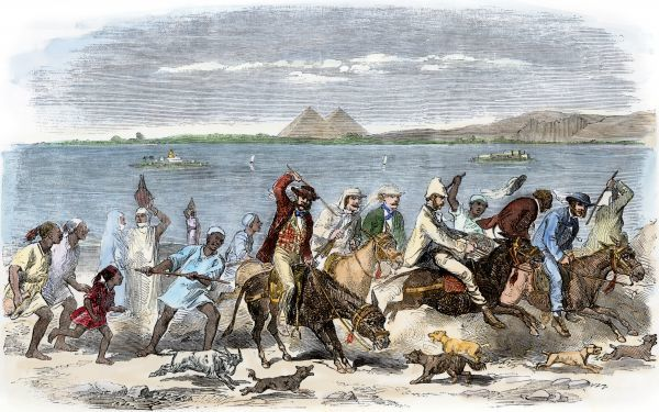 Tourists riding unruly donkeys to a picnic at the pyramids, Egypt, 1850s. Hand-colored woodcut of a 19th-century illustration
