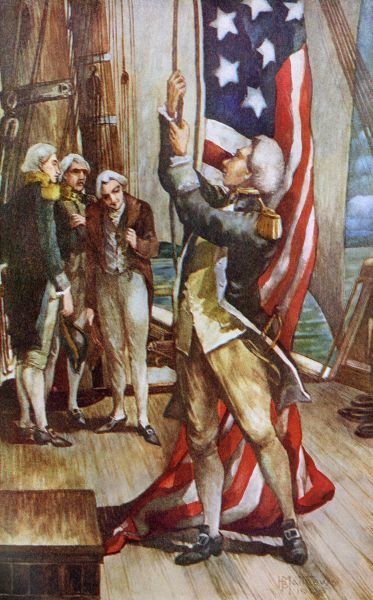 John Paul Jones raising the US flag on an American warship for the first time during the Revolutionary War. Printed color 19th-century illustration