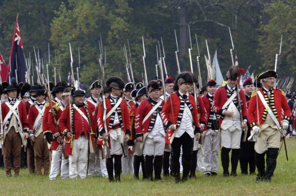 British army marches onto the field in a reenactment of the surrender at Yorktown Battlefield, Virginia