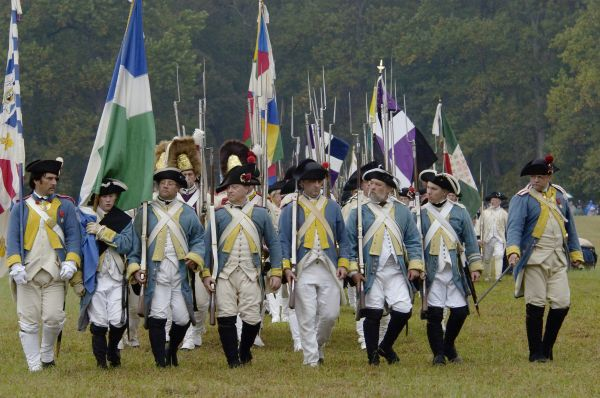 French troops take the field in a reenactment of the surrender at Yorktown Battlefield, Virginia. Digital photograph of a National Park Service event on the actual field of surrender at Yorktown Battlefield on the 225th anniversary of the surrender