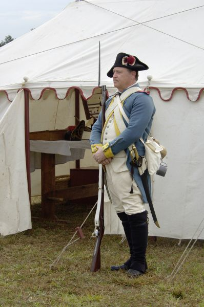 French soldier guarding Rochambeau's tent at a reenactment on the Yorktown Battlefield, Virginia. Digital photograph of a National Park Service event at Yorktown Battlefield on the 225th anniversary of the surrender