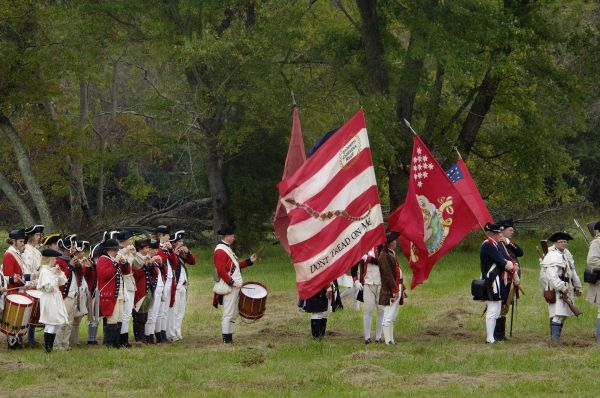 American army reenactors with the Rattlesnake Flag at Yorktown Battlefield, Virginia. Digital photograph of a National Park Service event at Yorktown Battlefield on the 225th anniversary of the surrender
