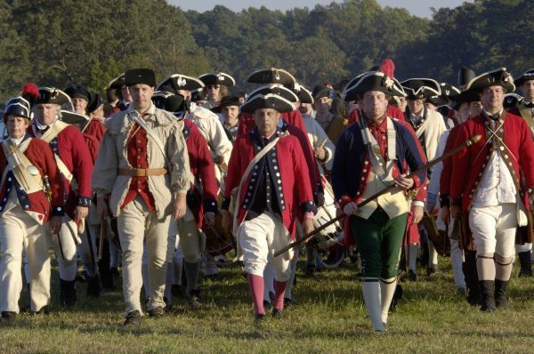 British troops marching in a reenactment on the Yorktown battlefield, Virginia. Digital photograph of a National Park Service event at Yorktown Battlefield on the 225th anniversary of the surrender