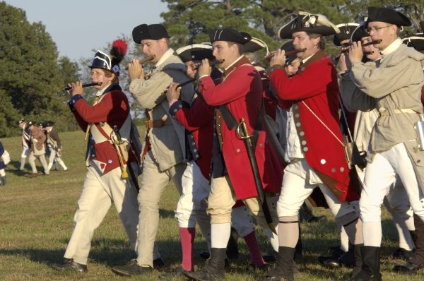 British fifers marching in a reenactment on the Yorktown battlefield, Virginia. Digital photograph of a National Park Service event at Yorktown Battlefield on the 225th anniversary of the surrender