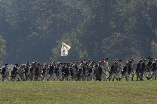 Continental Army soldiers reenact a march at Yorktown battlefield, Virginia. Digital photograph of a National Park Service event at Yorktown Battlefield on the 225th anniversary of the surrender