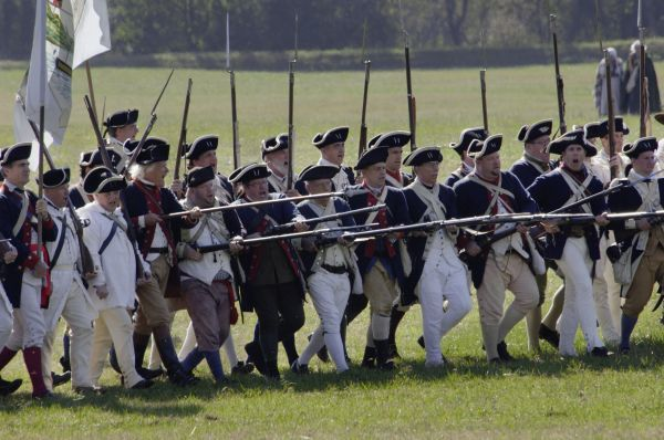 Continental Army reenactors advance at Yorktown battlefield, Virginia. Digital photograph of an 18th century living history demonstration at Colonial National Park Virginia
