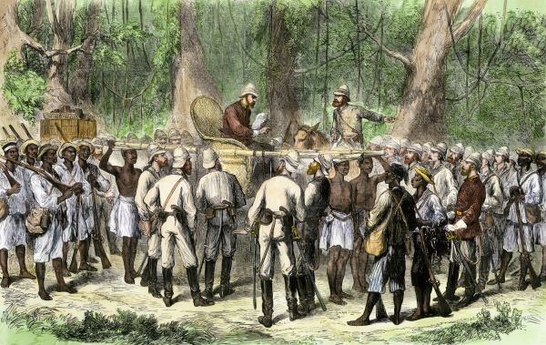 British officer Sir Garnet Wolseley receiving news during the Ashanti War in Africa, 1870s. Hand-colored woodcut of a 19th-century illustration