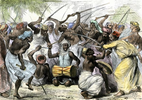 War-dance of the Sultan of Zanzibar's irregular troops, 1880s. Hand-colored woodcut of a 19th-century illustration