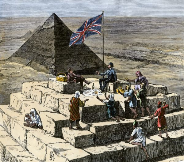 British tourists having Christmas lunch on the Great Pyramid, 1870s. Hand-colored woodcut of a 19th-century illustration