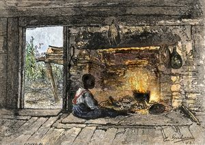 Boy keeping warm in a slave cabin