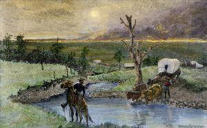 Covered wagons escaping a prairie fire
