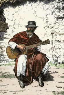 Gaucho playing his guitar, Argentina