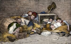 Homeless boys sleeping in an alley, 1890s