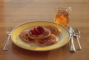 Maple syrup on homemade pancakes