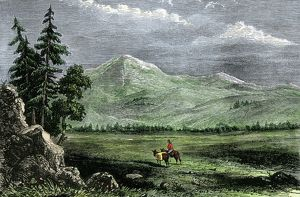 Pioneer with a pack horse in the Rockies