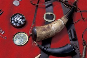 Powder horns and musket balls used in the fur trade