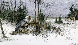 Woman hunting deer in the snow