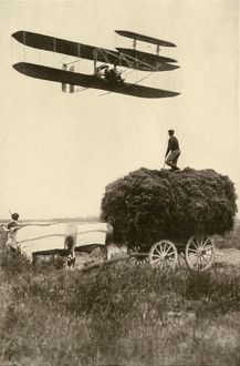 Wright airplane over a French farm
